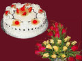 1 Kg Pineapple Cake With 25 Red & Yellow Roses Basket