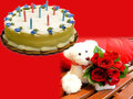 1 Kg Butterscotch Cake With 15 Red Roses & A Teddy