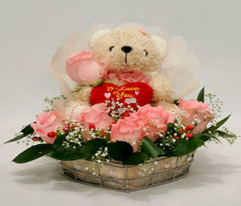 Surrounded_by_pink_floral_blooms_and_fragrance_divine_with_teddy_bear